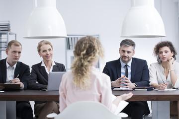 Headhunters examining potential employee