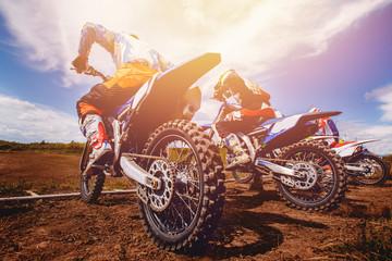 Dirtbike. Team Motocross on bike motorcycle is start road.