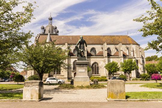 The Place de la République, with the statue of Georges Jacques Danton and the Church of Saint-Étienne in the background. Arcis-sur-Aube, Grand Est, France
