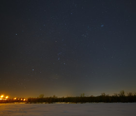 Stars in the night sky over the frozen river Don in Russia.