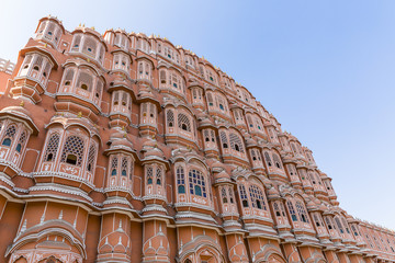 detailed view of red and pink sandstone facade of Hawa Mahal, Palace of Winds, Palace of the Breeze, Jaipur, Rajasthan, India