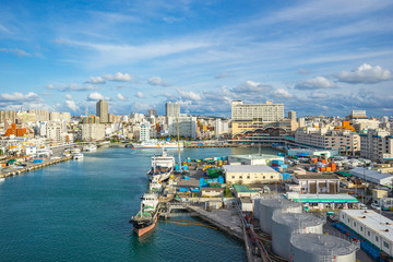 Tomari Port with Okinawa city skyline in Naha, Okinawa, Japan