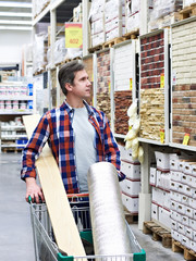 Man chooses and buys goods in store