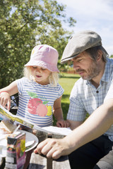 Man reading map with his daughter in Smaland, Sweden