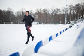 Photo of running sports man in stadium