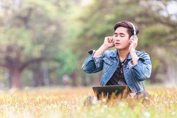 Asian young men listen to music