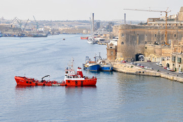 Port with ships on the picturesque island of Malta with beautiful monuments