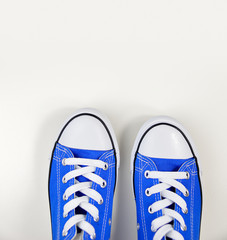 blue sneakers in white background