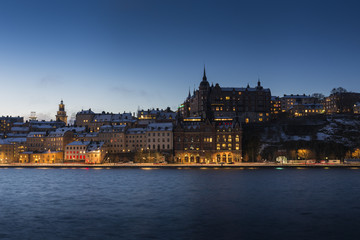 Buildings across water at night in Stockholm, Sweden