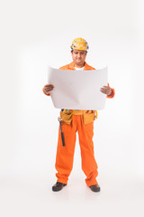 Indian electrician engineer in action with wire cutter, drilling machine etc, standing isolated over white background