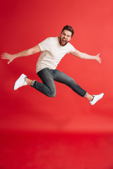 Excited emotional bearded man jumping