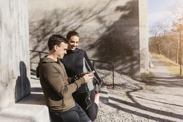 Couple on smart phone in Stockholm, Sweden