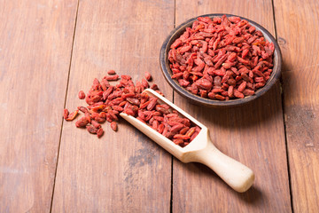 Goji berries in wooden spoon
