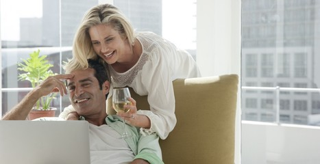 Portrait of mature couple is relaxing and smiling in the sitting