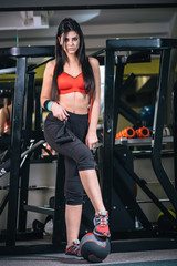 Young beautiful woman at gym
