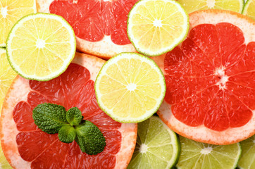 Citrus slices decorated with mint as background pattern