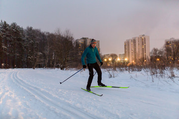 Picture of male skier in blue jacket in winter park