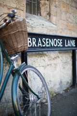 Bicycle Next To Brasenose Lane Sign Outside Oxford University College Buildings