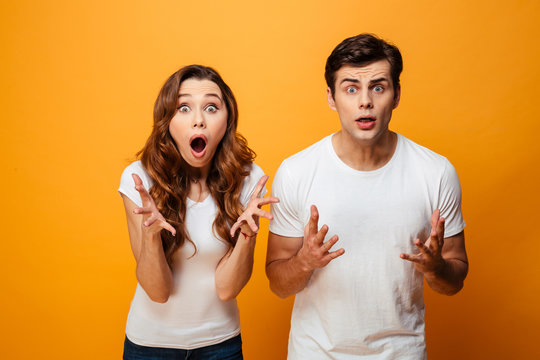 Portrait of a shocked young couple looking at camera