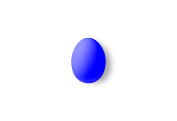 One blueOne red egg on a yellow background.  Minimalism style egg on a white background.  Minimalism style