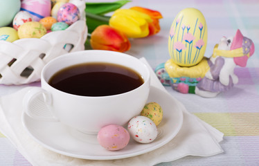 Cup of coffee and Easter candy treats
