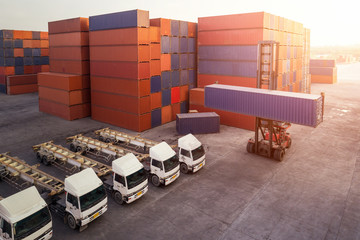 Fototapete - Truck for container with working crane bridge in shipyard for Logistic Import Export background