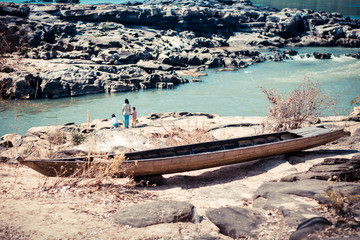 old wooden boat near river