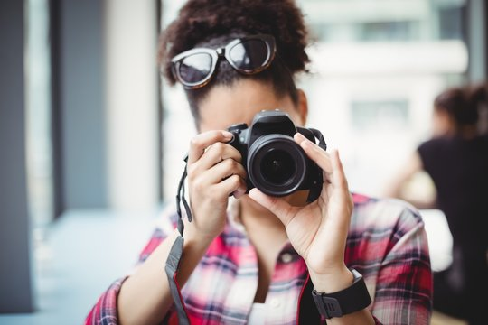 Woman photographing at restaurant