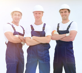 successful construction workers standing with arms crossed