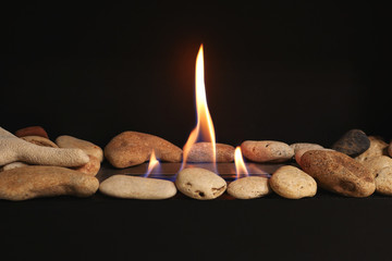 Modern interior bio fireplace with close up flame shooting. Fire flame flames of roaring gas burning outdoors at night