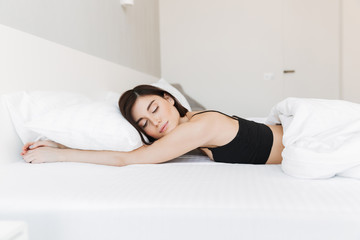 Portrait of a pretty young woman sleeping on a pillow