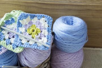 Balls of woolen threads and knitting needles. Scandinavian style.