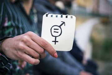 woman with a symbol for gender equality