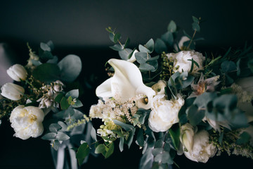 Beautiful wedding bouquets of the bride and girlfriend of the bride on a dark background