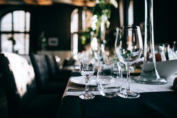 Beautiful dark Wedding table setting with fresh flowers decoration  and black table in the restaurant