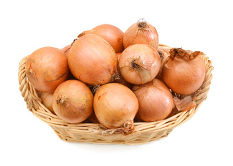 fresh onions vegetables isolated in basket on white background