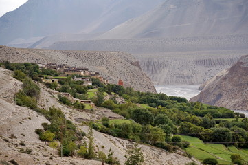 The village of Tangbe on the banks of the Kali Gandaki river in the valley of the Himalayan mountains. Upper Mustang. Nepal.