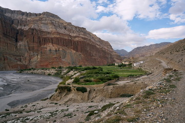 Chhusang cliffs and the village in the Kali Gandaki Gorge. Trekking to the Upper Mustang. Nepal.