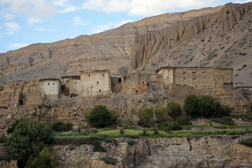 Old residential houses in Chhusang, against the backdrop of the mountain. Trekking to the Upper Mustang. Nepal.