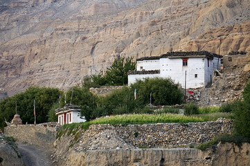 Nepalese house on the mountain at the entrance to the village of Chusang. Upper Mustang. Nepal.