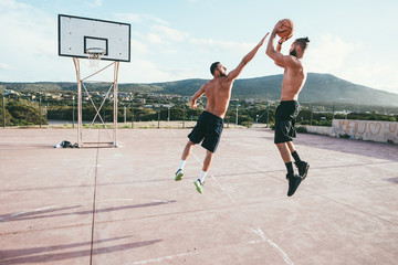 two young men bearded playing basketball