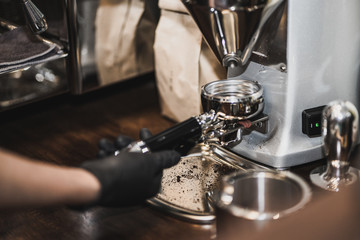 Barista cafe making of espresso pouring from coffee machine. Professional coffee brewing, close up