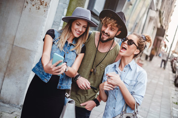 Friends taking selfie on the street and laughing