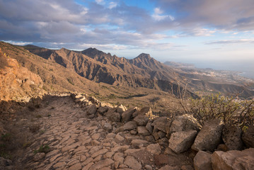 Tenerife mountain landscape. Trekking path. Adeje and Las Americas coastline in the background.