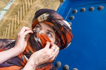 Arabian Moroccan woman with a scarf in Morocco