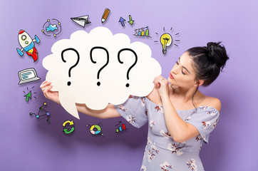 Question Marks with young woman holding a speech bubble