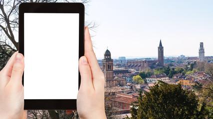 tourist photographs Verona city skyline in spring