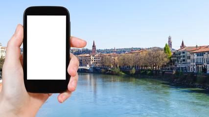tourist photographs Verona city on Adige rive
