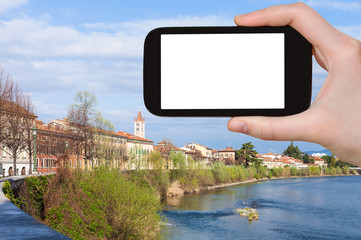 tourist photographs Verona city with waterfront