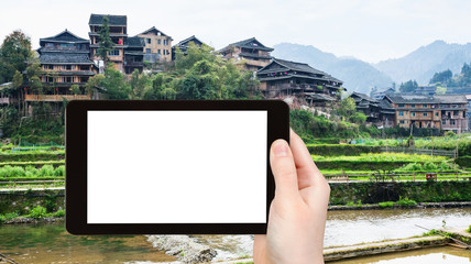 tourist photographs houses and terraced gardens